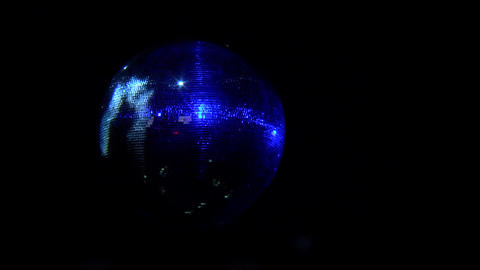 Night club atmosphere disco disco ball spinning and diffuses light blue - 043b Footage