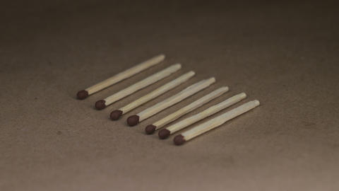 Wooden matches on rotating table Live Action