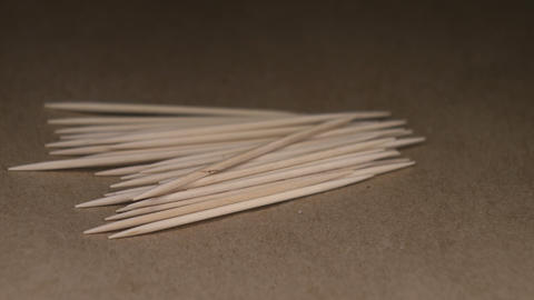 Wooden toothpicks on craft paper rotating table Archivo