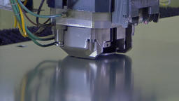 Figured cutting holes stamping of metal sheets on industrial CNC machine Footage