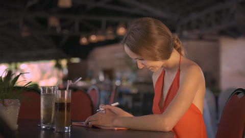 Girl Recalled Thought Writes down in Diary at Cafe Stock Video Footage