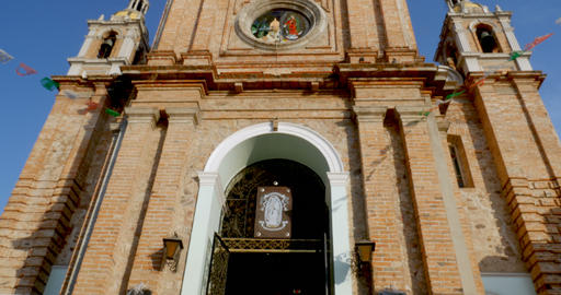 Tilt up low angle of the clock tower of the church of our lady of Guadalupe Footage