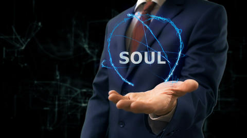Businessman shows concept hologram Soul on his hand Live Action