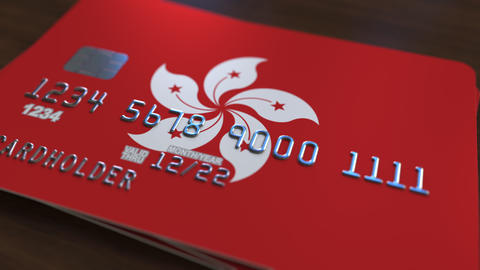 Plastic bank card featuring flag of Hong Kong. Banking system conceptual Footage