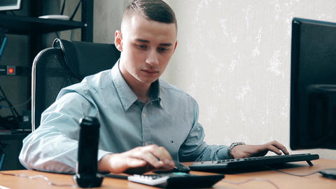The young Manager is trying to talk on two phones at the same time Footage