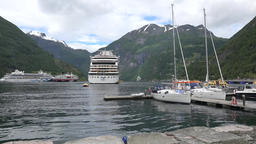 Norway Geiranger AIDA cruise ships at anchor and sail boats at jetty 영상물