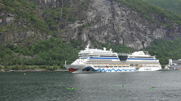North Europe Norway Geirangerfjord AIDA cruise ship in front of a rock face GIF