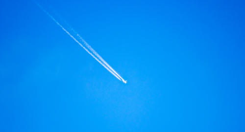 Aircraft in the blue sky フォト