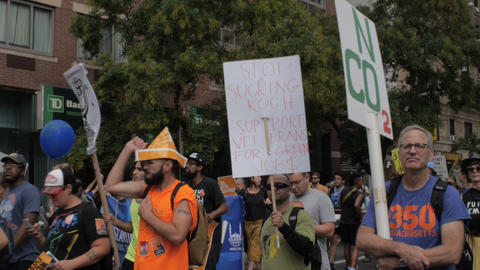 NEW YORK CITY, UNITED STATES - SEPTEMBER 21, 2014 - A man holding an anti Koch Footage