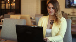 Business girl working using mobile computer sitting at table Footage