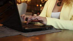 Close-up. Beautiful business woman is typing text on a mobile computer sitting Footage