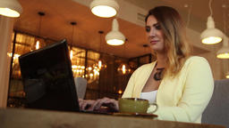 Beautiful business woman working using a mobile computer in a cafe in the Footage