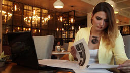 Business woman in business clothes examines working papers. Business style Footage