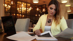 Business woman in business clothes examines working papers. Business style. HD Footage