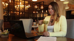 Business woman in business clothes drinking tea and examining documents Footage