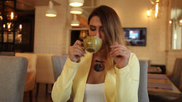 Business woman in business clothes drinking tea in a cafe sitting at a table Footage
