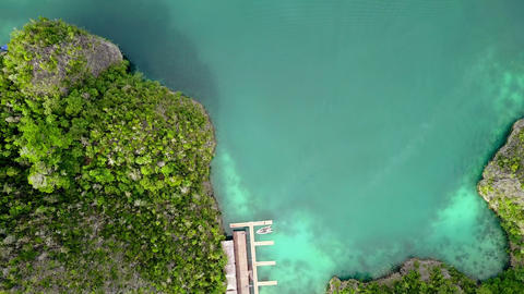 Boat Approaches the Pier and the Tropical Islands. Aerial View Footage