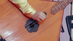Russian artist playing balalaika, close up Footage