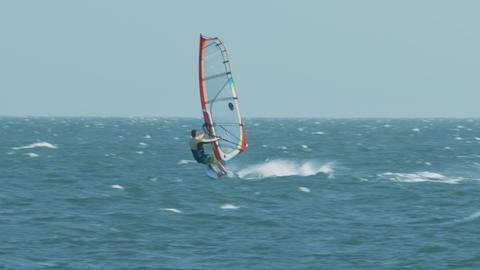 Windsurfer Sails on Foamy Waves on Windy Day Footage