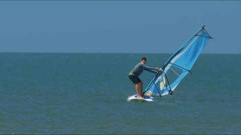 Guy Beginner Tries to Hold Sail Mast against Ocean Footage