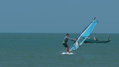 Guy Windsurfer Sails Past Fishing Boat at Ocean Footage
