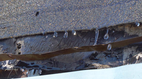 Melt water drops drip from the roof Footage