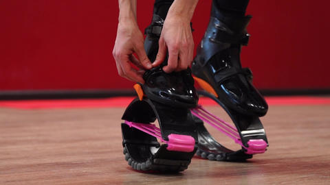 Close-up of the sport girl holding kangoo jumps. Girls are beautiful in 영상물
