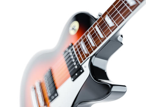Close up shot of a guitar, isolated on white Fotografía