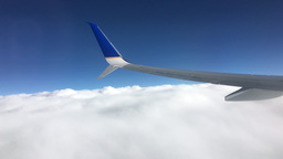 Plane wing flying above fluffy clouds Footage