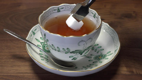 4K take Suger in hot brend tea Footage
