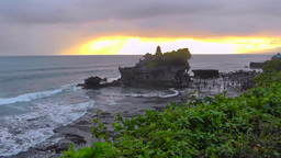 View of Tanah Lot Temple at sunset Footage