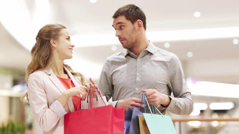 Happy Young Couple With Shopping Bags In Mall stock footage