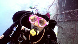 Scuba divers swimming explore shipwreck Salem Express deep underwater Footage