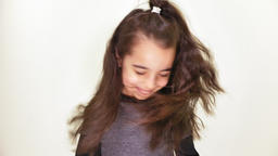 Little cute caucasian girl, smiling, shaking her head happily, laughing,portrait Footage
