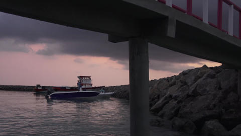 Rocky shore and bridge, ocean and boat. Maldives video Footage