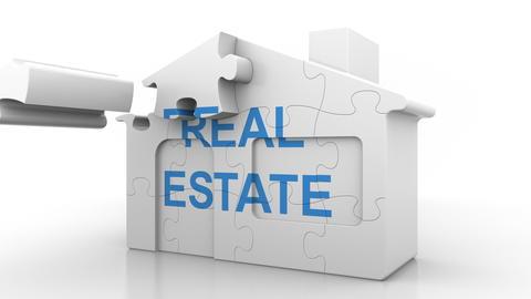 REAL ESTATE caption on puzzle house. Construction or mortgage market conceptual Fotografía