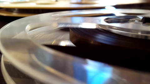 Rotation reel with tape on the video audio tape recorder player Closeup Footage