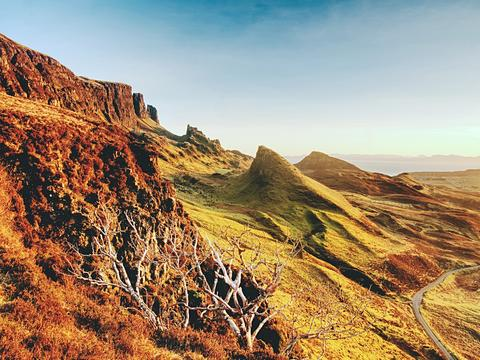 Sunny morning in Quiraing mountains. Hilly landscape of Isle of Skye Photo