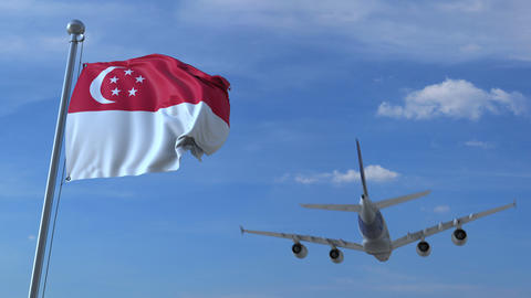 Commercial airplane flying above waving flag of Singapore. Singaporean Footage
