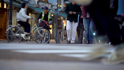 People cross a busy intersection in Matsuyama, Japan Footage