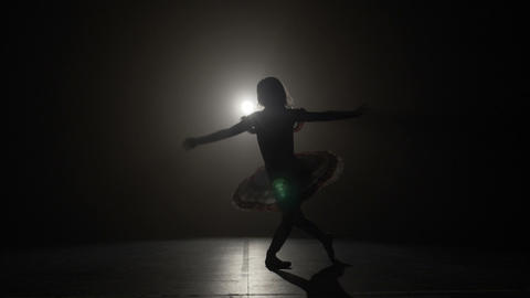 Skinny silhouette of a ballerina doing a graceful reverence in slow motion Footage