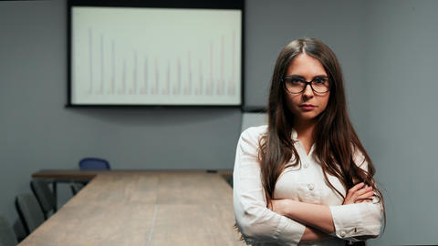 Portrait of beautiful girl in office clothes standing in… Stock Video Footage