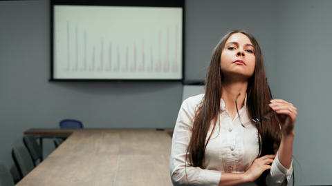 Portrait of beautiful girl in office clothes standing in conference room with Footage