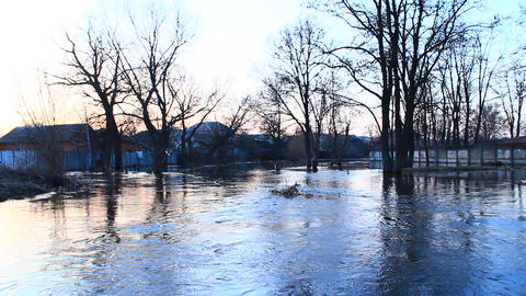 Flooding of river in spring during melting of snow. Natural disaster. Evening Archivo