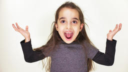 Little cute caucasian girl, smiling, showing an emotion of surprise, wide-open Footage