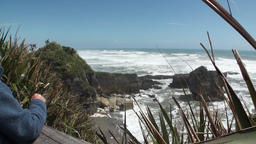 Waves and power water on a rocky coast and mountains New Zealand Footage