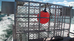 Fishing box cage on ship in ocean background of waves in New Zealand Footage