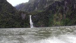 Power water of waterfall in a rocky coast and mountains New Zealand Footage