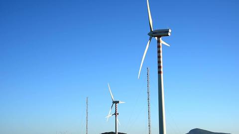 Wind turbines under a clear sky in the springtime. Sardinia, Italy Footage