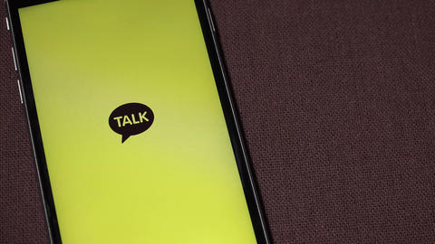 Message app KAKAO TALK logo on iphone screen ビデオ